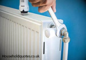 Man installing radiator valve and central heating